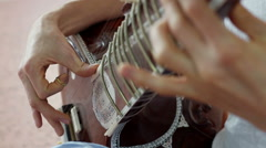 Indian music. Musician playing a musical instrument - sitar Arkistovideo