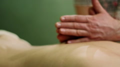 Massage procedure in spa salon. Masseur massaging the back of the girl. Stock Footage