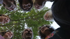 A large group of people huddle together in unison Stock Footage