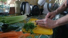Handheld Jewish elderly man chopping raw liver with a knife Stock Footage