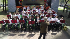 Children orchestra performing outdoor, aerial view - stock footage
