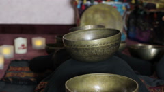 Playing a Tibetan singing bowls Stock Footage