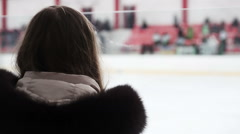 Excited female fan watching hockey match from tribune, supporting national team Stock Footage
