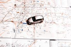 travel concept - small car on Seoul city map - stock photo
