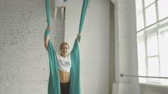 Pretty Woman - Aerialist Doing Acrobatic Tricks On Aerial Silks Stock Footage