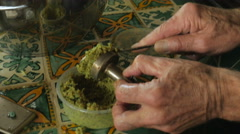 Close up of a man making homemade falafel and placing it in a pan Stock Footage