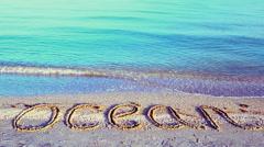 Inscription the ocean on the beach on sand. Stock Footage