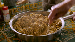 Close up of a man mixing chopped liver with a fork push-in Stock Footage
