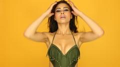 sexy woman wearing bikini on yellow - stock footage