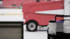 Maintenance worker driving resurfacer vehicle to make ice smooth and clean - stock footage