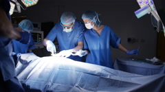 4K Team of surgeons in operating theater performing operation on a patient. Stock Footage
