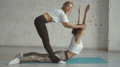 Yoga Trainer Helps Female Student To Stretch Back, Sport Practice With Partner - stock footage