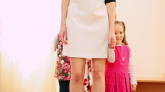 Funny little girl holding mom's hand. Slow motion Stock Footage