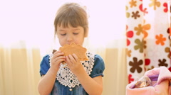 Sweet little girl eating cookies. Slow motion Stock Footage