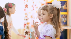 Cute girls in kindergarten at the lesson. Slow motion Stock Footage