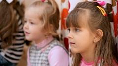 Cute little girl listening nurse. Close up. Slow motion Stock Footage
