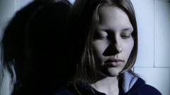Stressed teen girl fear of something and says with gesture to do silence. 4K UHD Stock Footage