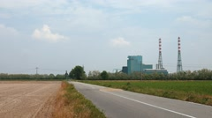 Incineration plant by a deserted road Stock Footage