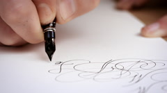 Writting letter with a pen. Calligraphy lesson. Close up. Slow motion Stock Footage
