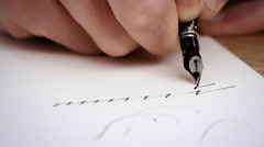 Writting letter with a pen. Calligraphy lesson. Close up. Slow motion - stock footage