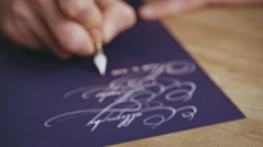 Writting letter with a pen. Calligraphy lesson. Close up Stock Footage