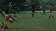 Group of boys playing football on a rainy day, Guatemala - stock footage