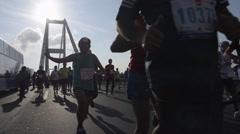People are running in public run on Bosporus Bridge, slow motion - stock footage