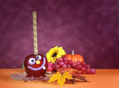 Halloween crazy face red toffee candy apples - stock photo