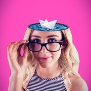 Composite image of gorgeous blonde hipster posing with glasses - stock photo
