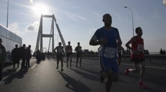 People running intercontinental marathon Eurasia, Istanbul, slow motion - stock footage