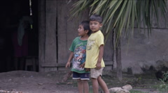Two boys standing outside a hut in village, Guatemala - stock footage