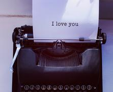 Composite image of i love you message on a white background Stock Photos