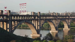 Bridge over river water. The bridge passes a stream of motor transport. Stock Footage