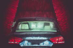 Automatic Brush Car Wash in Action. Elegant Modern Full Size Car Stock Photos