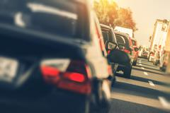 Heavy Two Lanes Highway Traffic. People Driving Back From Holidays. - stock photo