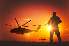 Military Mission at Sunset. Marines Helicopters Air Mission. - stock photo