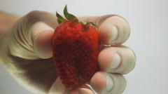 Grab strawberry from water Stock Footage