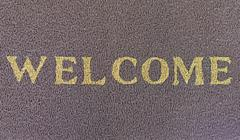 welcome text on brown doormat - stock photo