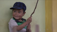 Little boy playing with a stick, Guatemala - stock footage