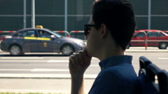 Pensive, young boy riding tram in city, super slow motion 240fps Stock Footage