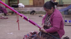 Woman weaving a shawl in village handloom, Guatemala - stock footage