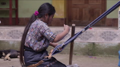 Woman weaving a shawl in village handloom, Guatemala Stock Footage