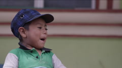Cute boy playing with a black funnel, Guatemala - stock footage