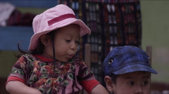 Mischievous girl spitting on her brother, Guatemala Stock Footage