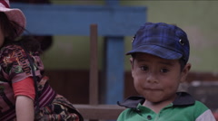 Cute siblings sitting together and looking around, Guatemala - stock footage