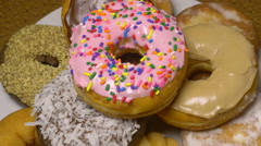 Donuts Assorted Rotating in a Pile 4k Stock Footage