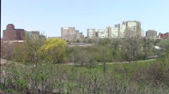 City setting with park in spring Stock Footage