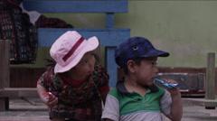 Cute siblings having chocolate together, Guatemala - stock footage