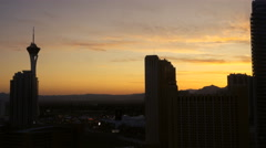 Golden predawn light silhouettes Las Vegas Stratoshpere and other buildings Stock Footage