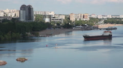 Ukraine. The city of Zaporozhye. Cargo ship sails on the river Dnieper. Stock Footage